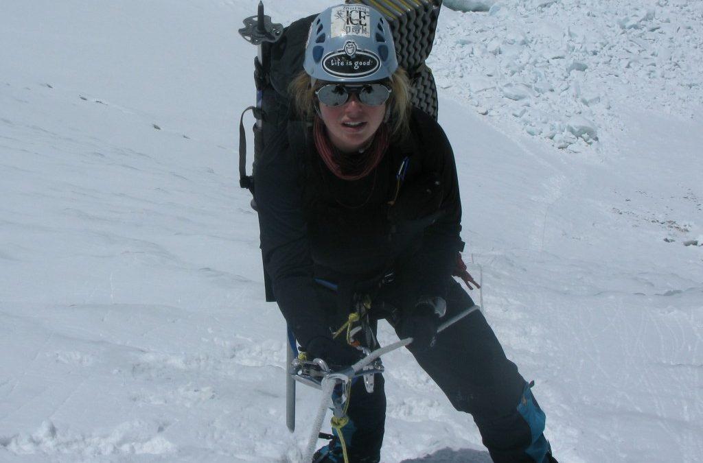 woman snow climbing